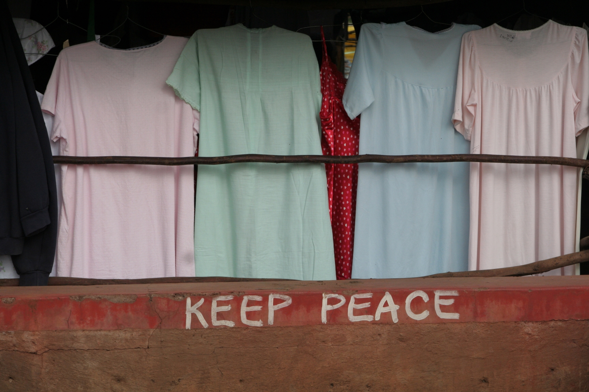 Kenya Nairobi Post Election market scene children's dresses Keep Peace graffiti art